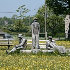 A sculpture depicting three resting miners