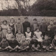 BRYNFORD SCHOOL 1940 - Infants and Classes 1 & 2 TEACHER : Miss Arfona Jones HEADMASTER : Mr Thomas BACK ROW : Eilwen Davies, Vera Parry, Eirlys Banford, Eva Roberts, Glyn Hughes, Glyn Ellis Jones, Teddy Williams, Glyn Williams, ? SECOND ROW : ?, Sheila Davies, Frances Davies, Shirley Collins, Sheila Pamela Davies, Edie Williams, Rosie Davies, Norah Davies, Gordon Marshall FRONT ROW : David Roberts, Edgar Roberts, Trevor Owen, Albert Jones, Gordon Davies, Derek Williams, Iorwerth Spencer, Cyril Griffiths
